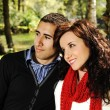 Young couple in nature sitting on bench, male and female together, love for — Stock Photo