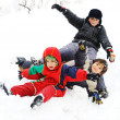 Stock Photo: Group of children happily playing in snow, winter