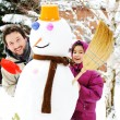 Stock Photo: Father and daughter, dad and girl playing game with snow-man, winter, decem