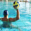 Waterpool goal and player with ball - Stok fotoğraf