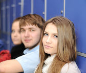 Group of teenagers, students at the college — Stock Photo
