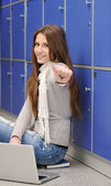 Beautiful female student sitting on ground with laptop - thumb up — Stock Photo