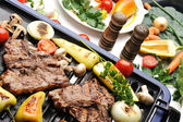 Barbecue, prepared beef meat and different vegetables and mushrooms on gril — Stock Photo