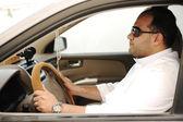 Arabic man driving a car — Stock Photo