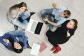 Creative group of students sitting and working together — Foto Stock
