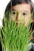 Kid with grass — Stock Photo