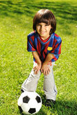 Cute little boy playing with a ball in beautiful park in nature — Stock Photo