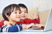 Kids using laptop — Stock Photo
