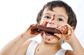 Kid with chocolate — Stock Photo