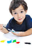 Cute kid playing with colors on white — Stock Photo