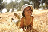Careless boy on yellow grass meadow in autumn — Stock Photo