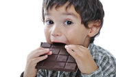 Very cute kid with chocolate, isolated — Stock Photo
