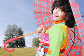 Cute school girl with umbrella outdoor, fall - autumn time — Stock Photo