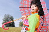 Cute school girl with umbrella outdoor, fall - autumn time — Stock Photo