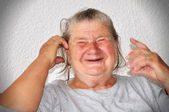 Old elderly woman with funny goody face — Stock Photo