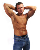 Macho man with jeans, chest, stomach and byceps, muscle body — Stock Photo