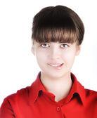Krásná mladá dospívající dívka s červenou košili skousla dolní ret - bílá backgro — Stock fotografie