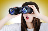 Girl with binoculars looking at the Earth — Stock Photo
