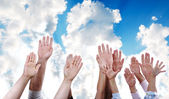 Many hands rising the sky together — Stock Photo