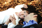 Close-up portrait of an beautiful autumn woman laying on ground — Foto de Stock