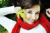 Close-up portrait of an beautiful autumn woman — Stock Photo