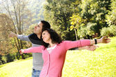 Two young relaxed in nature with opened arms looking up and breathin — Foto Stock