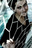 Girl stuck in net — Stock Photo