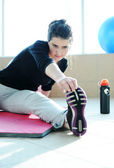 Fitness sporty girl with a ball at gym and bottle of water excercising — Stock Photo