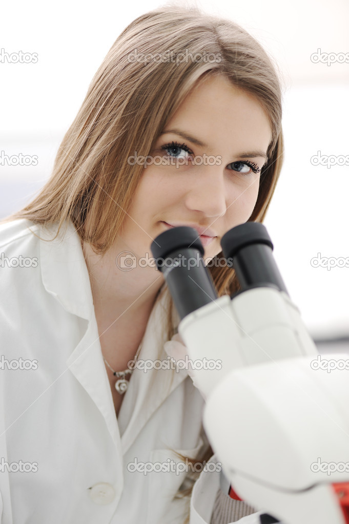 Beautiful female researcher using a microscope in a lab, closeup — Stock Photo #6150223