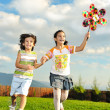 Fantastic scene of happy children running and playing carefreely on green m — Stock Photo