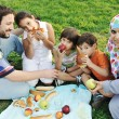 Muslim family, mother and father with three children together in nature sit — Stock Photo #6186454