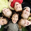 Stock Photo: Happiness without limit, happy group of children in circle, together outdoo