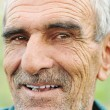 Stock Photo: Face portrait of wrinkled cheerful smiling senior man