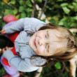 Beauty blond baby on tree leaves ground with closed eyes — Stock Photo #6187355