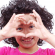 Girl with heart shaped hands — Stockfoto