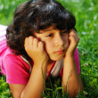Stock Photo: Girl on grass glancing