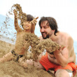 Playing together in sand on beach, young father and a little son — Stock Photo