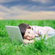 Stock Photo: Cute kid with laptop on green meadow, nature scene