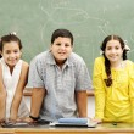 Three children in classroom — Stock Photo
