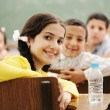 Happy cute children in classroom with their teacher — Stock Photo #6187701