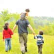 Stock Photo: Happy family in nature, father and children walking