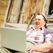 Senior aged woman with laptop — Stockfoto