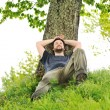 Happy young man resting under the tree — Stock Photo #6187798