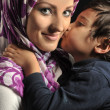 Stock Photo: Muslim young womwith little cute kid