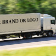 Big truck photographed from back side, no logo except great place for your — Stock Photo