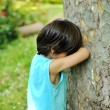 Kid hiding - Stock Photo