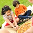 Royalty-Free Stock Photo: Eating pizza, picnic, family outdoor