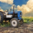 Very old tractor in field, different parts - no trademark at all — Stock Photo