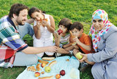 Muslim family, mother and father with three children together in nature sit — Stok fotoğraf