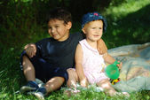 Two children on grass — Stock Photo